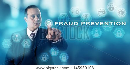 Experienced forensic investigator with a stern look pressing a virtual push button that activates the term FRAUD PREVENTION. Computer and civil crime metaphor law enforcement and business concept.