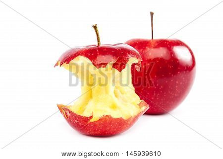 Fresh red apples and apple core isolated on white background.