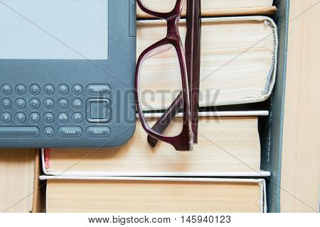 Several thick books with modern grey eReader