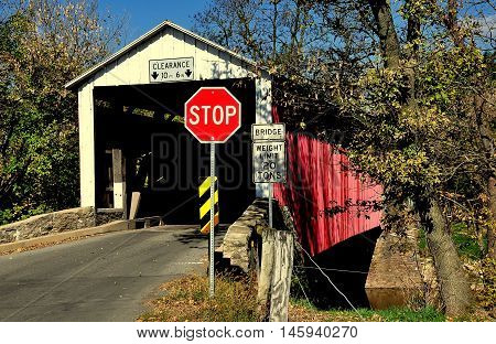Goodville Pennsylvania - October 19 2015: Single lane wooden red covered brudge over the Conestoga River