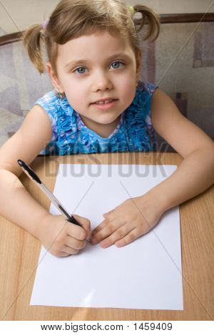 Small Girl Learns To Write