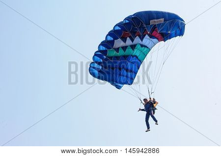 Tyumen, Russia - August 11, 2012: On a visit at UTair air show in heliport Plehanovo. Paratrooper man landing in show program
