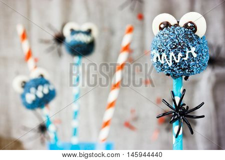 Funny pop cakes for Halloween party selective focus