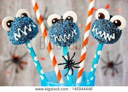 Halloween blue monster cake pops selective focus