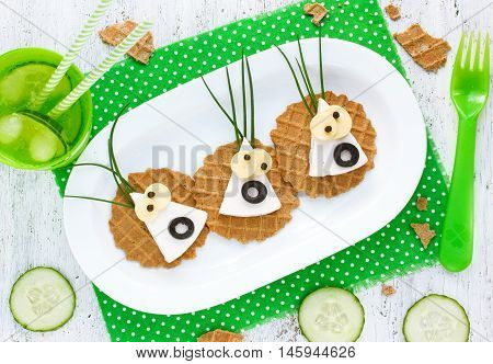 Scary halloween food canape for halloween celebration party decorated with funny eyes
