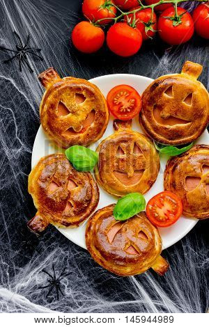 Pumpkin mini pizzas to Halloween party treats creative idea for the festive food top view