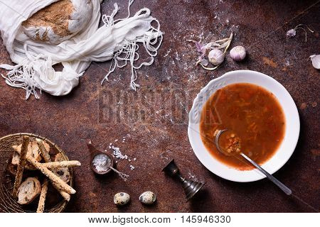 Vegetable spanish gazpacho soup with crispy crust bread, food background. Top view, coy space.