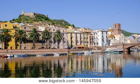 View on Bosa the river Temo with boats and the Castle Serravalle in Sardinia Italy.