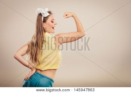 Happy Pretty Pin Up Girl Showing Off Muscles.