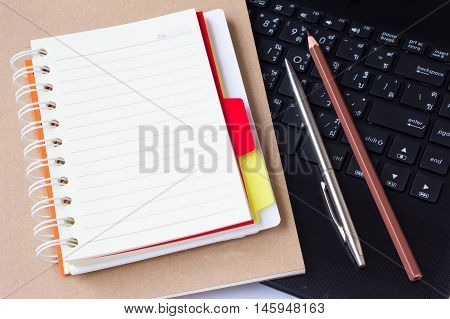 blank paper note on computer / can be used for your text or artwork / Top view