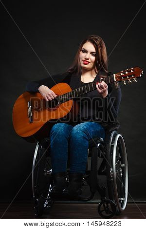Handicapped Girl Holding Guitar.