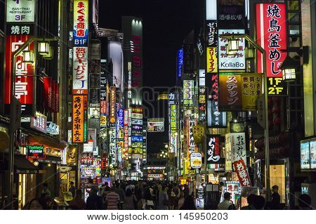 TOKYO, JAPAN - APRIL 24, 2016: Billboards in Shinjuku's Kabuki-cho district in Tokyo, Japan