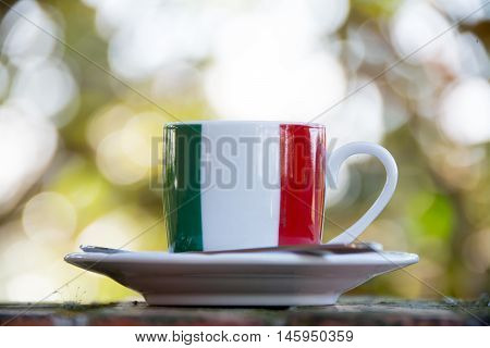 Italian coffee. Cup with italian flag in outdoor