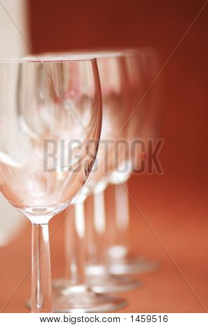 Four Glasses Arranged In The Row - Shallow Dof