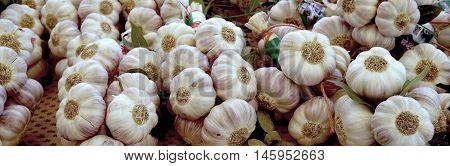 St Aygulf, Var, Provence, France, August 26 2016: Fresh Garlic Bulbs On A Provencal Market Stall In
