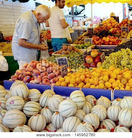 St Aygulf, Var, Provence, France, August 26 2016: A Customer Checking The Kiwi, Peaches, Grapes, Mel