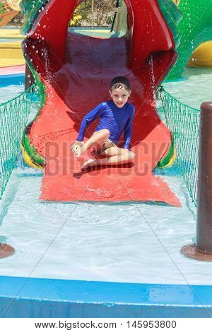 Boy Having Fun In Pool Water Park