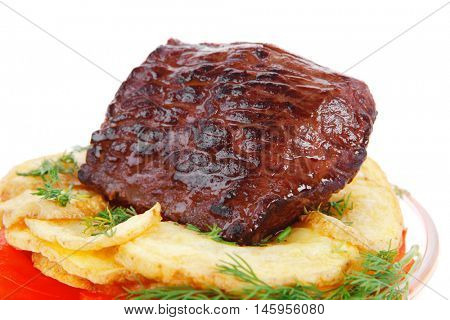 fresh roast beef meat chunk in transparent bowl over baked potatoes and tomatoves served with fill isolated over white background