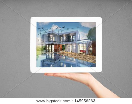 3D Rendering of project of new house in a tablet screen