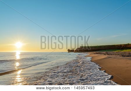 Ocean coast at the sunrise (Central Coastal Drive Prince Edward Island Canada)