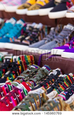 Pisac Peru - May 15: Colorful shoes for sale at the Sacred Valley Market. May 15 2016 Pisac Peru.