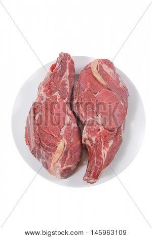 two fresh raw red ribeye beef steak on big white plate isolated over white background rib eye