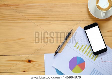 Office desk table with blank screen smartphonepenanalysis chart and cup of coffee .Top view with copy space.Office desk table concept.Office supplies and gadgets on desk table.