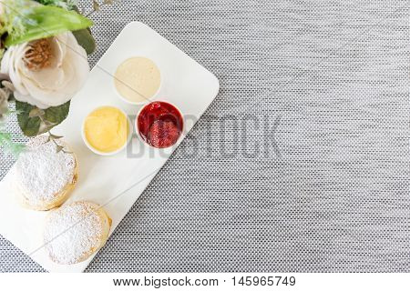 Scone With Jam And Cream On Table Background