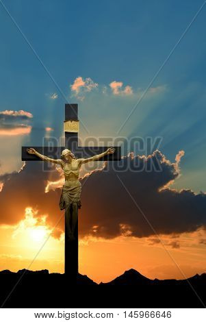 Jesus Christ on the cross over bright sky background vertical image