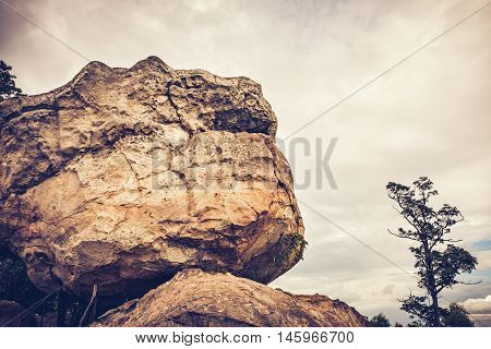 Boulders Against Sky With Cloudy Over Tranquil Nature, Outdoor At The Daytime. Vintage Tone.