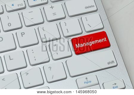 Management word on red button keyboard. business concept