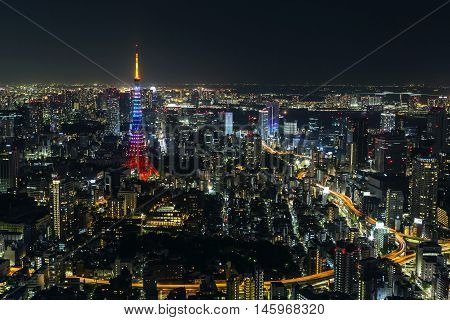 Tokyo tower with rainbow lights at night in Tokyo, Japan