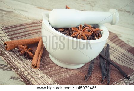 Vintage Photo, Fragrant Cloves And Anise In Mortar And Spices On Rustic Board