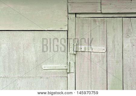 Old Wooden Hangar Door With Metal Hinges.