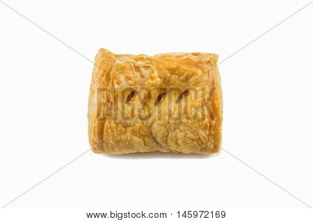 Yellow salty crispy pie with meat inside isolated on white background having soft shadow below