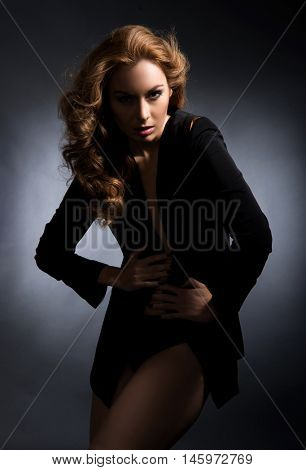 Young, beautiful and fit fashion model posing in studio