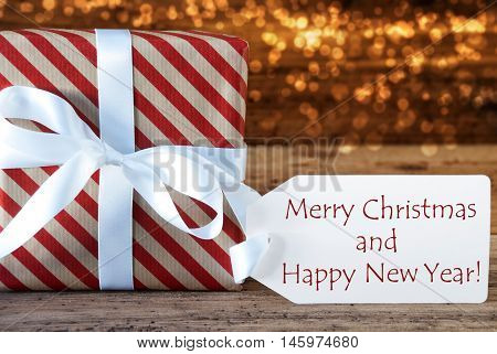 Macro Of Christmas Gift Or Present On Atmospheric Wooden Background. Card For Seasons Greetings, Best Wishes Or Congratulations. White Ribbon With Bow. English Text Merry Christmas And Happy New Year