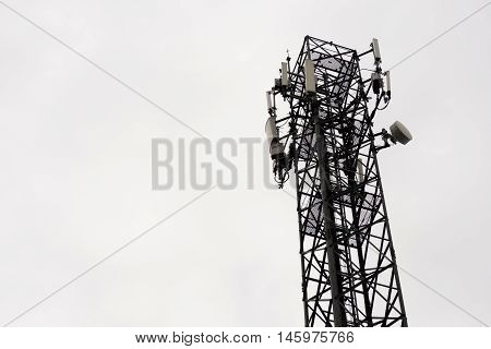Communication towers in the sky is overcast in isolated