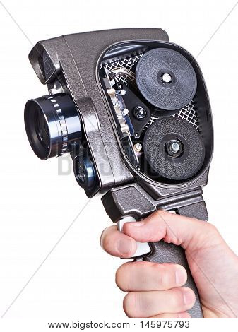 Retro Mechanical Movie Camera In Hands Of Operator With Cover Open Isolated