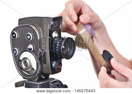 Retro Mechanical Movie Camera And Film In Hands Operator Isolated