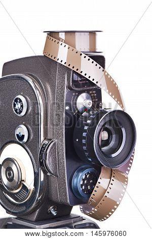 Retro Mechanical Movie Camera And Film Isolated