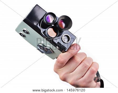 Retro Movie Camera In Hands Of Operator Isolated
