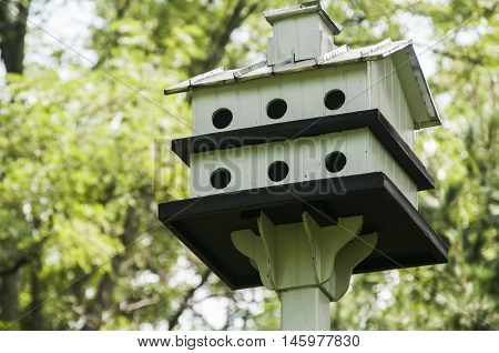 White painted wooden two storey bird house