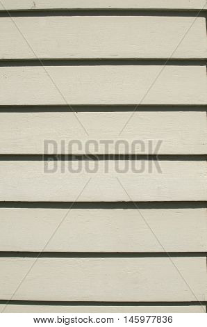 White painted wooden boards of american style house wall as background