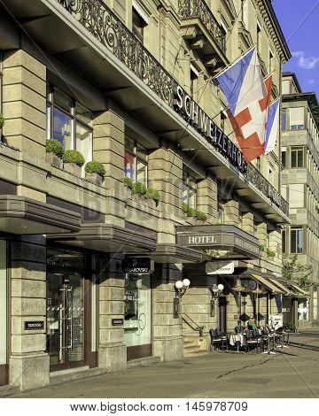Zurich, Switzerland - 30 July, 2016: Hotel Schweizerhof building facade view from Bahnhofplatz square. Hotel Schweizerhof Zurich is located directly opposite Zurich main train station where the famous shopping avenue Bahnhofstrasse begins.