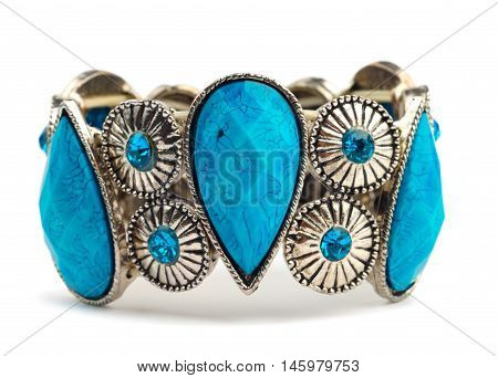 Bracelet with blue stones isolated over white background. Clipping path included.