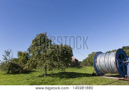 Big reel with cable in the countryside