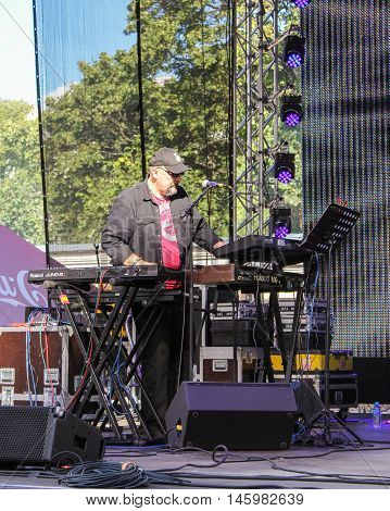 St. Petersburg, Russia - 12 August, The musician playing the electric piano,12 August, 2016. Pop and rock musicians on Harley Davidson festival in St. Petersburg.