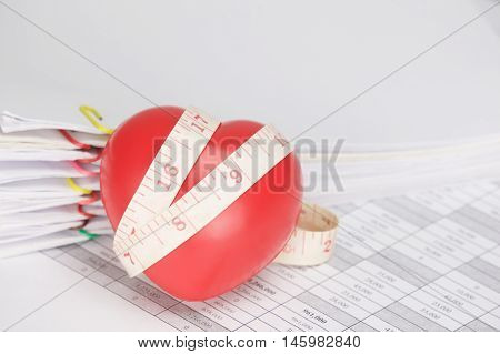Red Heart With Measuring Tape On Finance Account As Background