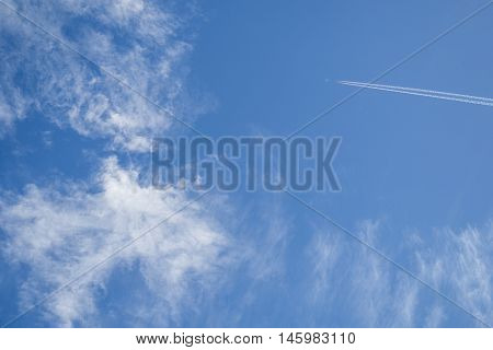 Jets flying in the sky with clouds in the morning sun shine